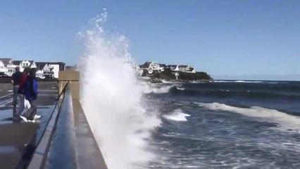 Guy Standing on Causeway Gets Splashed by Huge Wave