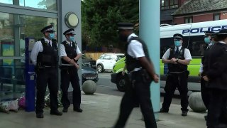 Police officers lay flowers in honour of colleague