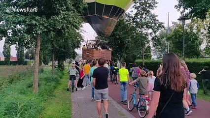 Heroic bystanders save hot air balloon from crash landing in Netherlands