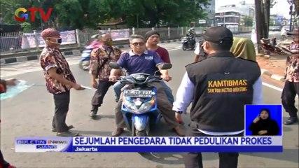Polisi dan Ormas Gelar Sidak Masker di Tugu Proklamasi Jakarta