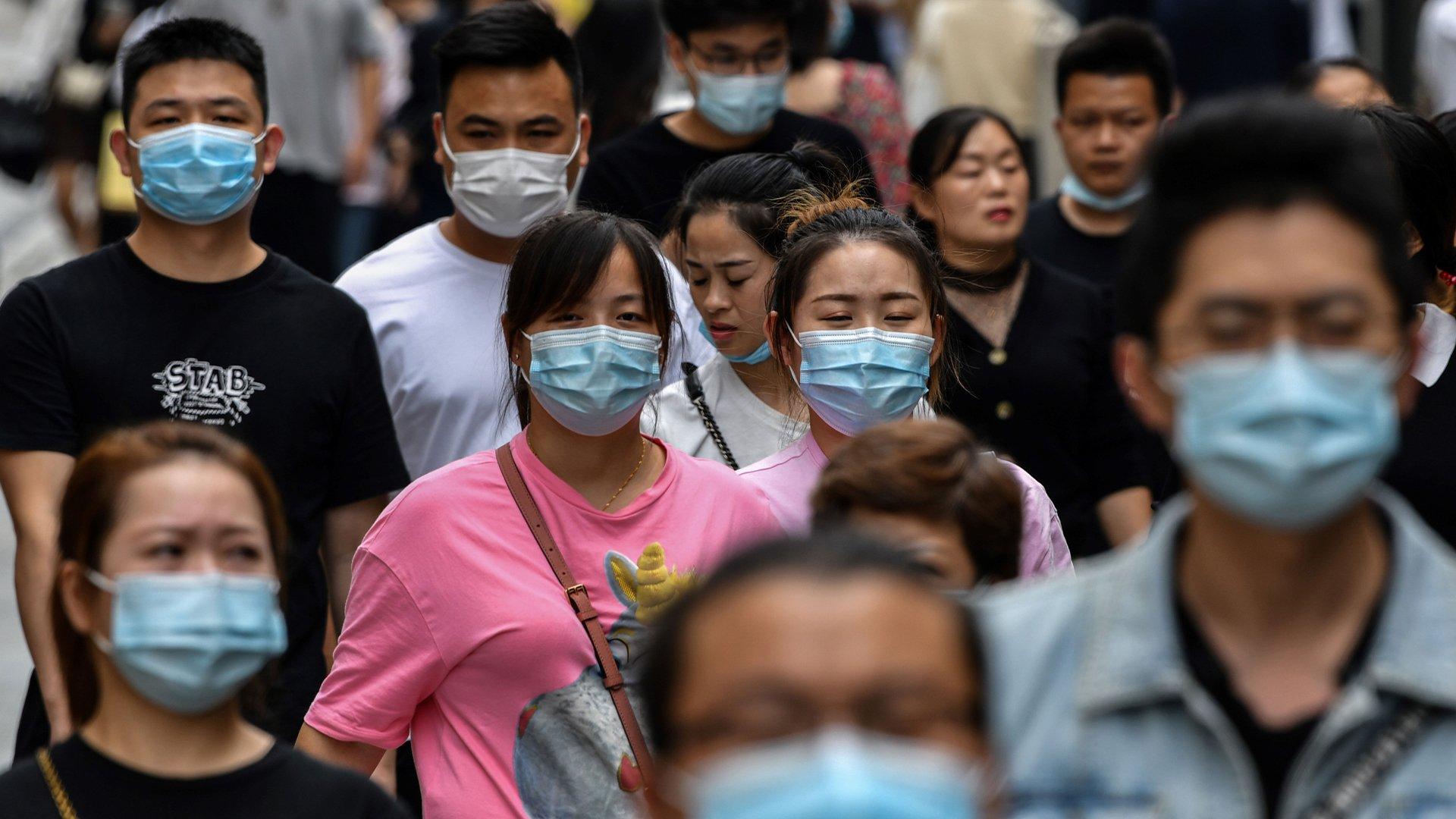 China's Wuhan moves on as global coronavirus death toll passes 1 million