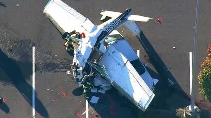 Pilot survives after crashing into car