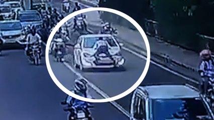 Shocking moment traffic violator drags cop on hood