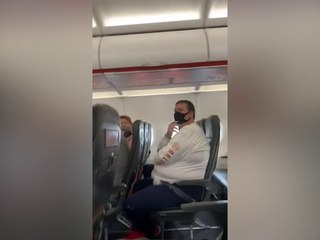 Woman shouts 'everybody dies' as she coughs on airplane passengers