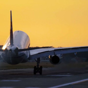 airplane landing in slow motion in a yellow sky