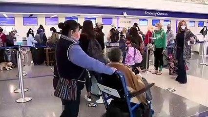 Millions travel for Thanksgiving despite warnings