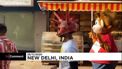 'COVID warriors' with virus-shaped hats spread awareness in India