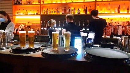 Behind the Wall in Falkirk customers enjoying a pint at 6pm as the districtmoved into Level 2
