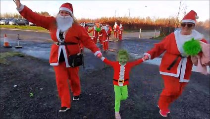 Friends Santa dash for Strathcarron Hospice Lemmy a Miniature Pinscher was the star and Poppy-Jane too