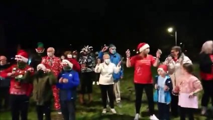 Lauren Sinclair from Facebook page Worldwide Santa's Christmas Eve Jingle with family friends and neighbours jingling their bells