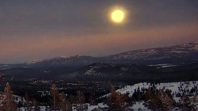 Cold Moon rises above snowy Lake Tahoe