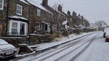 Snow falling on the North York Moors