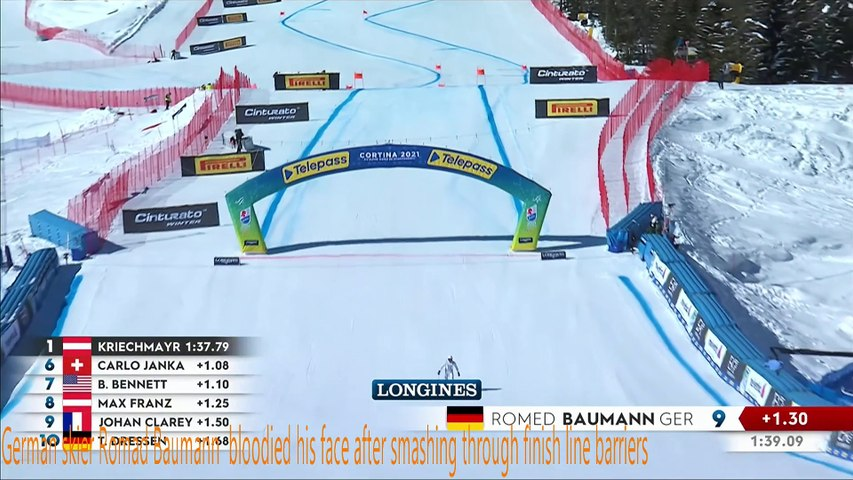 German skier Romad Baumann bloodied after smashing through finish line barriers