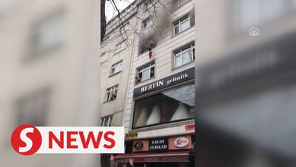 Woman and neighbours save four children in Istanbul fire