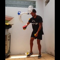 Guy Wears Pipe Over Forehead to Put Ping Pong Ball Inside After Hitting it While Juggling Balls