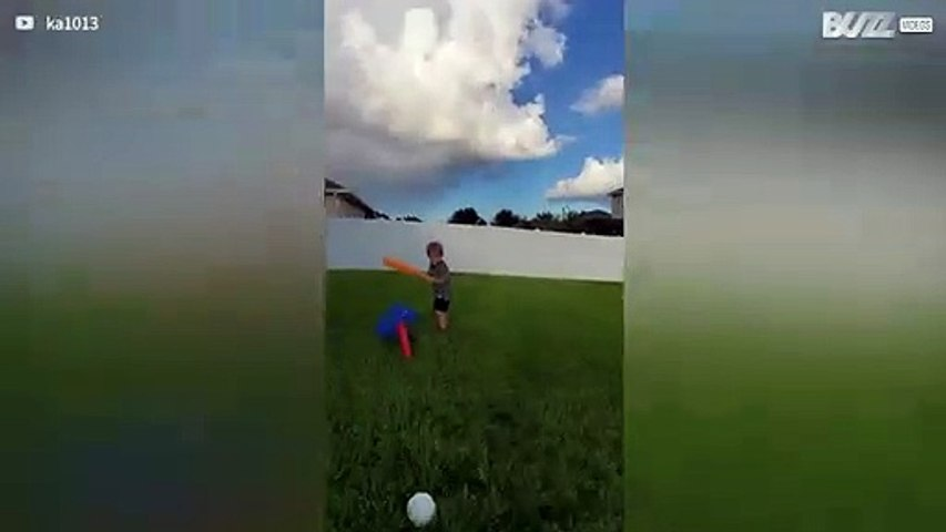 Boy hits dad in the face with ball
