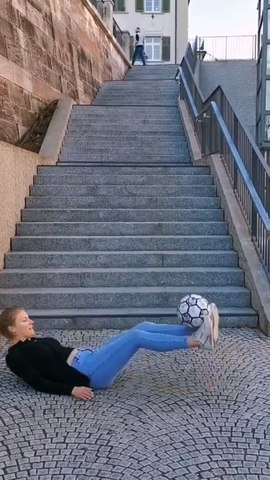 Woman Expertly Balances Football on Different Parts of Her Body