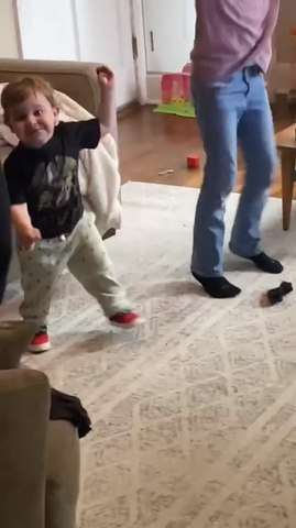 Excited Toddler Enjoys Dancing With Family
