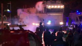 Police use water cannon to try and disperse rioters in Northern Ireland after a week of violence