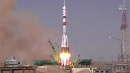 Manned Soyuz spacecraft docks with ISS