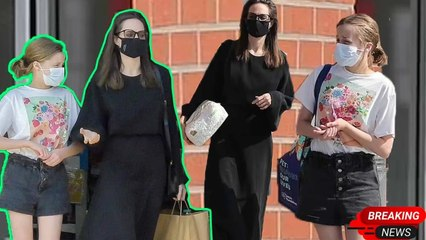Good girls! Angelina exuded sophistication in a chic black dress as running errands with daughter