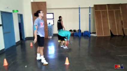 Phoenix works on passing with heavy ball in practice