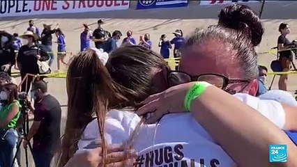 Separated families embrace at US-Mexico border for 'Hugs Not Walls'