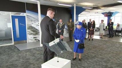 Queen and Princess Anne visit satellite centre