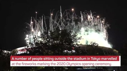 Fans applaud Tokyo Olympics opening ceremony fireworks from outside stadium