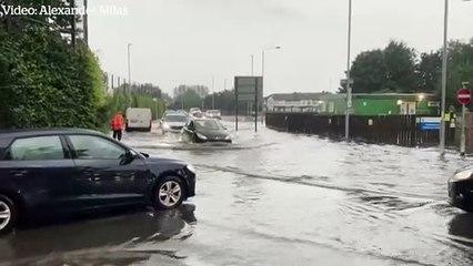 Heavy rains cause flooding on London streets