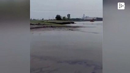 A mound of earth rises from the water in a rare natural phenomenon