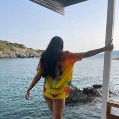 Dua Lipa Wore a String Bikini with a Surprising Cover-Up