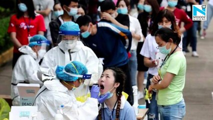 China's Wuhan to test all residents as COVID cases emerge after a year