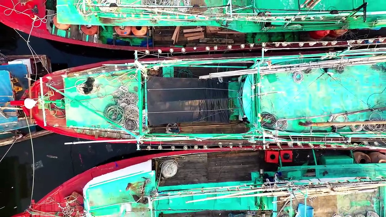 GoPro Shoot Of Fishing Boats Docked In Rows In The Sea Harbour _ Video No 11 _ Drone Shot
