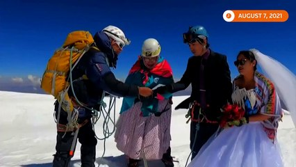 Bolivian couple marry atop majestic Illimani mountain