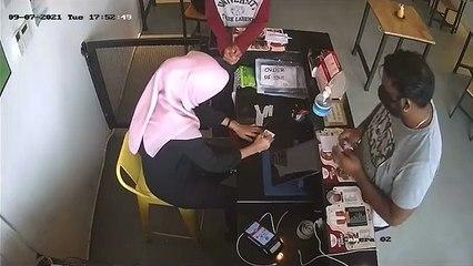 老千指收到餐馆老板联络 骗女收银员取走RM900