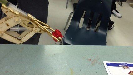 Person Demonstrates Workings of Hydraulic Arm