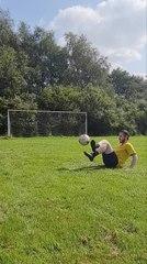 Person Skilfully Juggles Football Before kicking it Through Goal