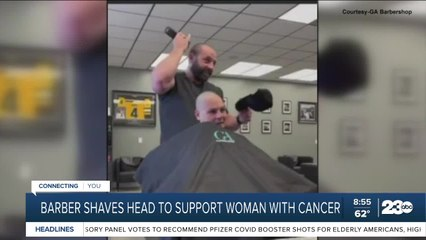 Barber shaves head to support woman with cancer