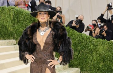 Why does Jennifer Lopez feel like an 'outsider' in Hollywood?