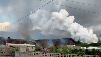 Hundreds of homes destroyed as lava pours from volcano in Spain
