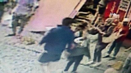 Başından vurduğu hamile eşini kucağında caddeye taşıdı