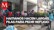 En CdMx, migrantes hacen largas filas afuera de Comar para pedir asilo en México