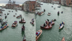 'Venice, Italy: Quartet of musicians perform on a violin-shaped boat'