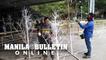 Davao City personnel refurbish steel Christmas trees for the Pasko Fiesta celebrations