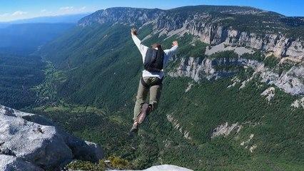 Daredevils jump from 500-meter-high cliff in vertigo inducing footage