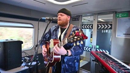 Tom Walker sings on a train