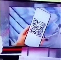 Il scanne le QR Code montré au journal télévisé !