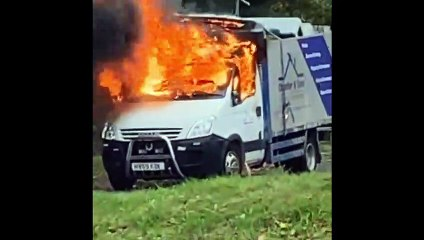 Van bursts into flames as children play football nearby