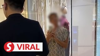 Online uproar over video of maskless woman kicking up a stink at luxury boutique